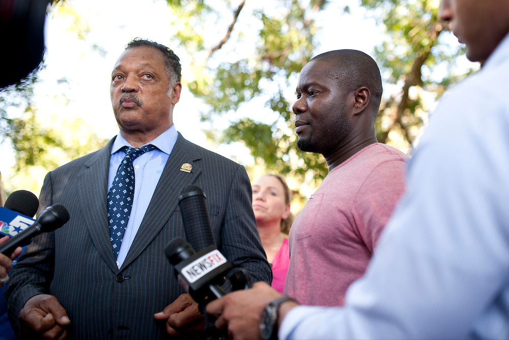 Rev. Jesse Jackson and Josephus Weeks, nephew of Ebola patient Thomas Eric Duncan answer questions during a prayer vigil for Duncan at Texas Health Presbyterian Hospital on October 7, 2014, in Dallas. (Cooper Neill for The New York Times)