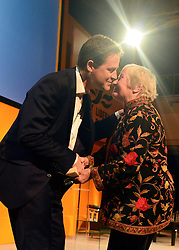 © Licensed to London News Pictures. 08/03/2013. Brighton, UK. Leader of the Liberal democrats and Deputy Prime Minister Nick Clegg congratulates Dame Shirley Williams after she talks to delegates on International Women's Day at the Party Rally Liberal Democrat Spring Conference in Brighton today 8th March 2013. Photo credit : Stephen Simpson/LNP