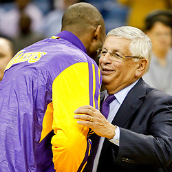 Dec 5, 2012; New Orleans, LA, USA; NBA Commissioner David Stern on the court with Los Angeles Lakers shooting guard Kobe Bryant (24) before a game against the New Orleans Hornets at the New Orleans Arena.  Mandatory Credit: Derick E. Hingle-USA TODAY Sports