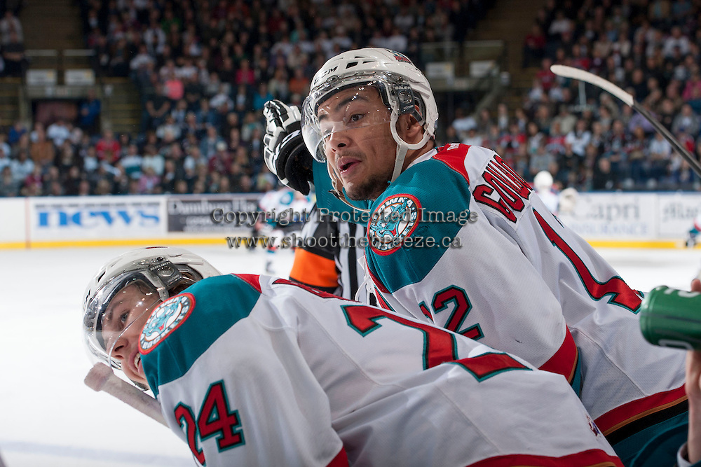 KELOWNA, CANADA - APRIL 19: Tyrell Goulbourne #12 of the Kelowna Rockets responds to trash talk from Matthew Dumba #24 of the Portland Winterhawks on April 18, 2014 during Game 2 of the third round of WHL Playoffs at Prospera Place in Kelowna, British Columbia, Canada.   (Photo by Marissa Baecker/Shoot the Breeze)  *** Local Caption *** Tyrell Goulbourne; Tyson Baillie;