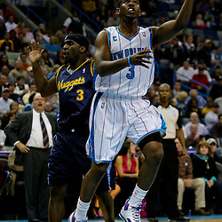 Dec 18, 2009; New Orleans, LA, USA;  New Orleans Hornets guard Chris Paul (3) drives past Denver Nuggets guard Ty Lawson (3) during the first half at the New Orleans Arena. Mandatory Credit: Derick E. Hingle-US PRESSWIRE