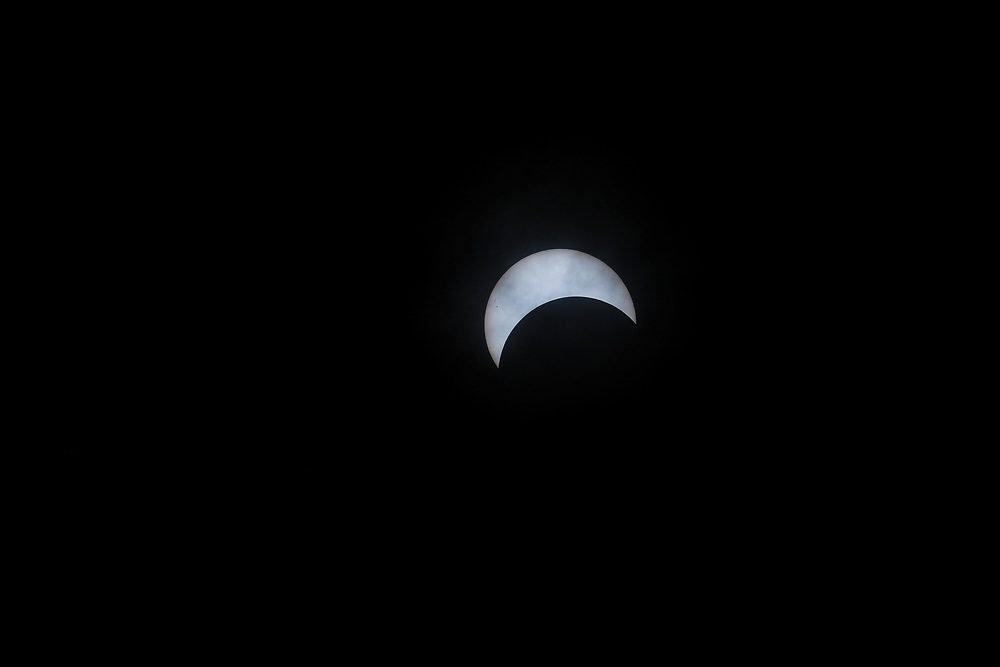 New England astronomy photography featuring the 2017 solar eclipse over the Greater Boston Area. Originally, I was not planning on photographing this astronomical phenomenon but then remembered my 300mm lens that I don't care for anymore. I added my older camera to the setup and combine a 10 stop and 5 stop neutral density filter to capture some images of this historic US solar eclipse. Massachusetts and Boston as well as other parts of New England were only treated to partial eclipse but still impressive to see the magic unfold. <br />