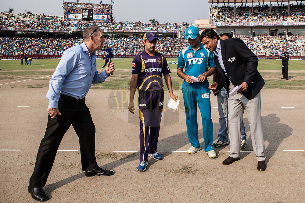 KKR captain Gambhir(L) , PWI captain Sourav Ganguly and match reffery and others watching the toss coin during match 47 of the the Indian Premier League ( IPL) 2012  between The Kolkata Knight Riders and The Pune Warriors India held at the Eden Gardens Stadium in Kolkata on the 5th Mayl2012..Photo by Saikat Das/IPL/SPORTZPICS