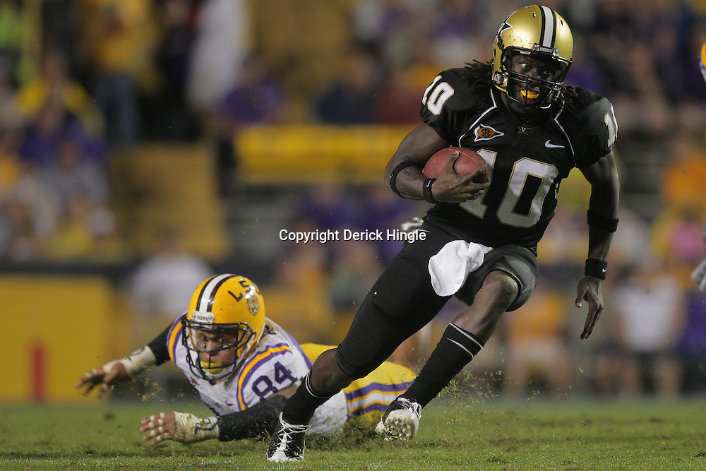 Sep 12, 2009; Baton Rouge, LA, USA;  Vanderbilt Commodores quarterback Larry Smith (10) runs away from LSU Tigers defensive end Rahim Alem (84) during the second half at Tiger Stadium.  Mandatory Credit: Derick E. Hingle-US PRESSWIRE