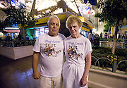 """A couple wear matching """"dog lover"""" t-shirts on their holiday in Las Vegas, Nevada."""