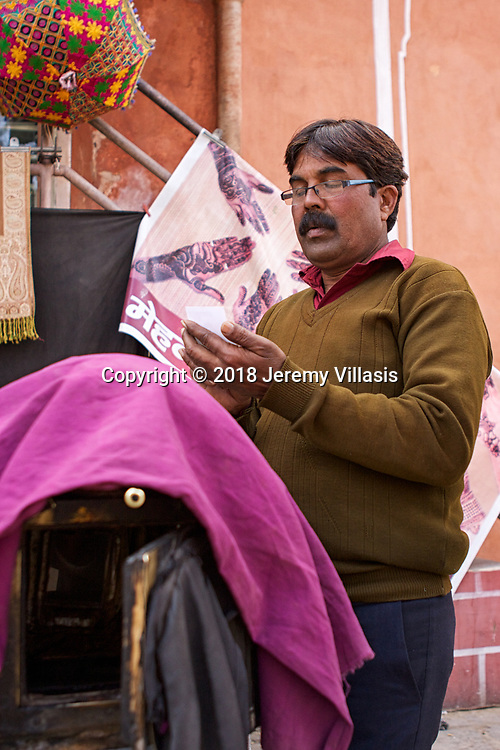 Tikam Chand at work. The last practicing street portraitist in India today. He is a third generation photographer whose family has sustained the profession for almost a hundred years.