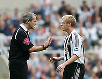 Photo: Andrew Unwin.<br />Newcastle United v Wigan Athletic. The Barclays Premiership. 19/08/2006.<br />Newcastle's Damien Duff (R) is calmed down by the referee, Martin Atkinson (L).