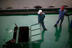 SOUTH KOREA MASAN 25OCT07 - Refuelling barge and Korean workers alongside in Masan port, South Korea...jre/Photo by Jiri Rezac..© Jiri Rezac 2007..Contact: +44 (0) 7050 110 417.Mobile:  +44 (0) 7801 337 683.Office:  +44 (0) 20 8968 9635..Email:   jiri@jirirezac.com.Web:    www.jirirezac.com..© All images Jiri Rezac 2007 - All rights reserved.