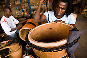 A man makes a drum at the Village Artisanal de Ouagadougou, a cooperative that employs dozens of artisans who work in different mediums, in Ouagadougou, Burkina Faso, on Monday November 3, 2008.