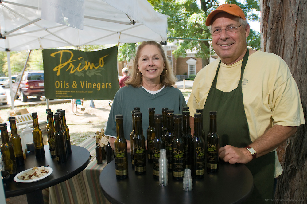 Beverly Bromley and Bob Hundley of Primo Oils and Vinegars at their booth at the Douglas Loop Farmers Market Saturday, Aug. 18, 2012 in Louisville, Ky. (Photo by Brian Bohannon)