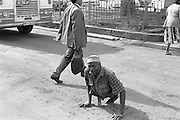 A man crosses a busy road in downtown Nairobi, Kenya. Polio afflicts many in Kenya but is nearing eradication.