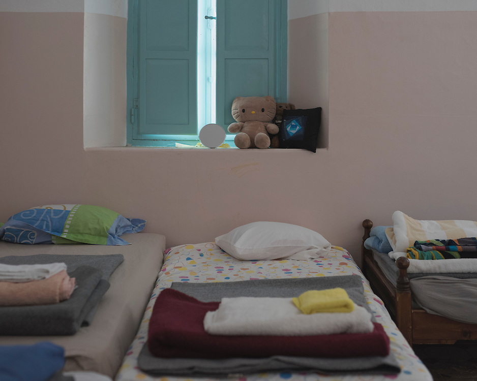 Made up beds in one of the rooms of Villa Artemis.<br /> <br /> The Villa, inside the Hospital of Leros compound opened in September 2015 and it was a shelter for 30 women with their children run by the Leros Solidarity Network. It was abandoned in early April 2016 after the change in EU policy on refugees and the creation of the &ldquo;Hot Spot&rdquo; camp in Lepida, Leros.