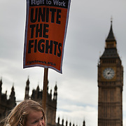 A young demonstrator listens to the meeting on how to occupy London, not just Westminster Bridge..The Health and Care Bill has been passed by Parliament and is due to go to the House of Lords. In protest against the bill which aim to deconstruct and privatise large parts of the NHS UK Uncut activists together with health workers and trade unionists blocked the Westminster Bridge from 1pm til 5.30pm.