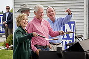US Secretary of State Hillary Rodham Clinton is guest of honor at the annual barbeque party hosted by Iowa Senator Tom Harkin. At the party she hinted strongly that she was ready to run as Presidential candidate for the 2016 election. Here she is flipping burgers with her husband Bill Clinton and their host Senator Tom Harkin.