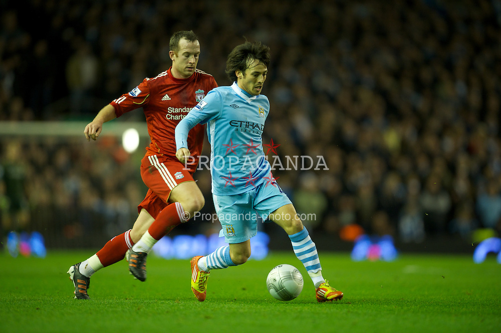 LIVERPOOL, ENGLAND - Wednesday, January 25, 2012: Liverpool's Charlie Adam in action against Manchester City's David Silva during the Football League Cup Semi-Final 2nd Leg at Anfield. (Pic by David Rawcliffe/Propaganda)