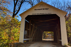 2015 Oct 19:   Parke County Indiana is the site of the Indiana Covered Bridge Festival every October.  This is the Marshall Bridge.  It was built over Rush Creek on County Road 900n in 1917 by JA. Britton. The bridge has a 56' span.<br /> <br /> This image was produced in part utilizing High Dynamic Range (HDR) processes.  It should not be used editorially without being listed as an illustration or with a disclaimer.  It may or may not be an accurate representation of the scene as originally photographed and the finished image is the creation of the photographer.