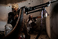 Libya, Sirte: Fighters of the Libyan forces affiliated to the Tripoli government aim at ISIS positions in Al Jiza neighbourhood on the frontline with ISIS in Sirte on November 24, 2016.  Alessio Romenzi