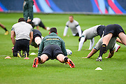 South Africa players warm up in rain during the South Africa Training Session in preparation for the Rugby World Cup at Eastbourne College, Eastbourne, United Kingdom on 16 September 2015. Photo by David Charbit.