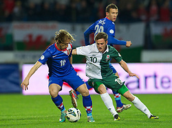 OSIJEK, CROATIA - Tuesday, October 16, 2012: Wales' Andy King in action against Croatia's Luka Modric during the Brazil 2014 FIFA World Cup Qualifying Group A match at the Stadion Gradski Vrt. (Pic by David Rawcliffe/Propaganda)