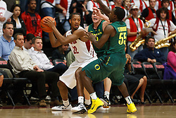 January 27, 2011; Stanford, CA, USA;  Stanford Cardinal guard Jarrett Mann (22) is defended by Oregon Ducks guard Jay-R Strowbridge (55) and guard Garrett Sim (3) during the first half at Maples Pavilion.