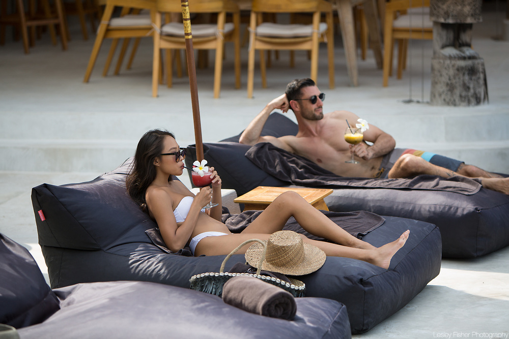 A couple relaxing at the pool at Karma Beach Resort, a unique resort located on Bophut Beach, Koh Samui, Thailand