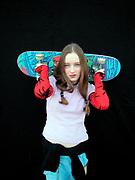 Girl holding up a skateboard