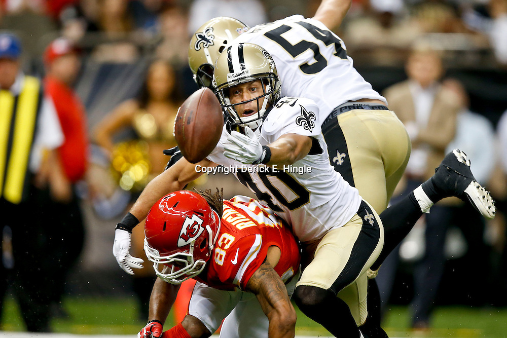 Aug 9, 2013; New Orleans, LA, USA; New Orleans Saints defensive back Chris Carr (40) reaches for a deflected pass as he collides with Kansas City Chiefs wide receiver Rico Richardson (83) during the second half of a preseason game at the Mercedes-Benz Superdome. The Saints defeated the Chiefs 17-13. Mandatory Credit: Derick E. Hingle-USA TODAY Sports