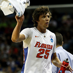Mar 26, 2011; New Orleans, LA; Florida Gators forward Chandler Parsons (25) waves a towel to fan during the first half of the semifinals of the southeast regional of the 2011 NCAA men's basketball tournament against the Butler Bulldogs at New Orleans Arena.   Mandatory Credit: Derick E. Hingle