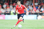 Wes York of York City (11) drives forward with the ball during the Vanarama National League North match between York City and Stockport County at Bootham Crescent, York, England on 7 August 2018.