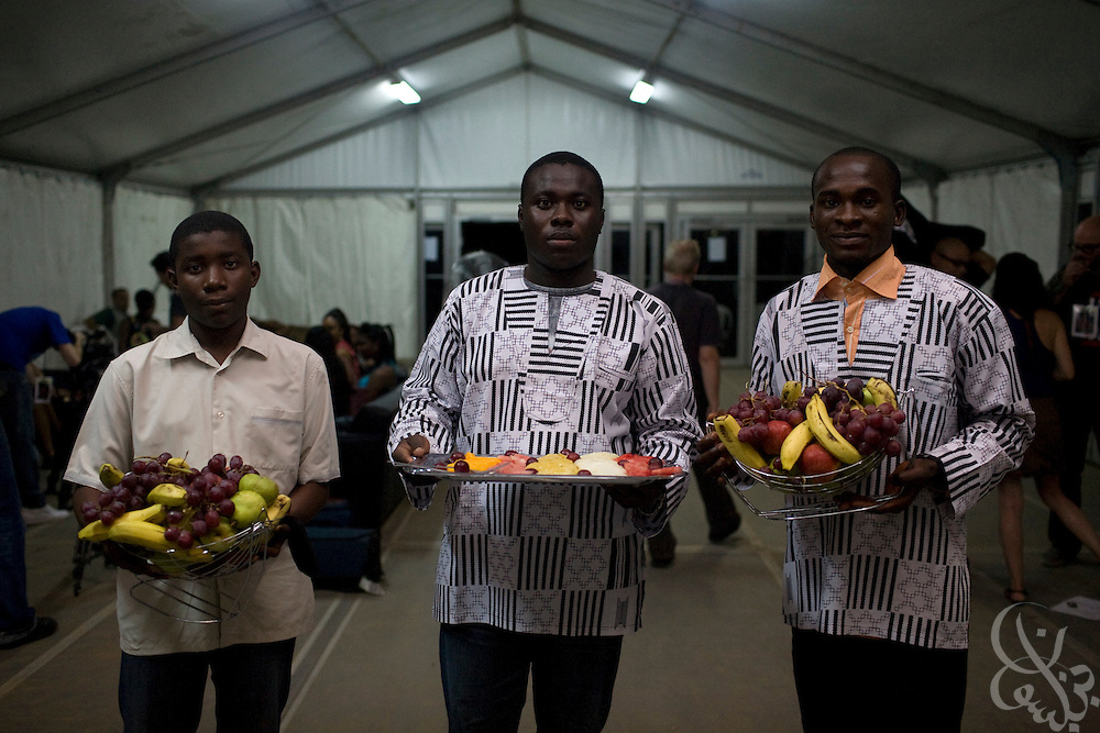 Nigerian waiters carry fresh fruit arrangements for the VIP tent at the Dome concert hall for the July 11, 2008 3rd annual THISDAY music and fashion festival in Abuja, Nigeria. The annual festival is designed to raise awareness of African issues while promoting positive images of Africa using music, fashion and culture in a series of concerts and events in Nigeria, the United States and the United Kingdom. .