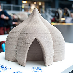 London, UK - 7 November 2013: a 3D printed house model made of clay by the WASProject is on display at the 3D Printshow at the Business Design Centre in London. WASP is a brand owned by Massimo Moretti's CSP srl and is specialized in design, development and production of projects for saving the world with digital technologies, creating huge 3D printers able to print clay-houses and help solving the problem of bidonvilles in the 3rd world.