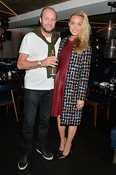 NOELLE RENO and SCOT YOUNG at a dinner to celebrate London Fashion Week SS 2015 and the opening of Ramusake at 92 Old Brompton Road, London on 15th September 2014.