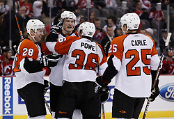 Oct 3, 2009; Newark, NJ, USA; The Philadelphia Flyers celebrate a goal by Philadelphia Flyers center Darroll Powe (36) during the third period at the Prudential Center. The Flyers defeated the Devils 5-2.