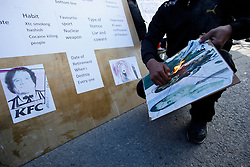 A protestor sets fire to a poster showing Libyan leader Muammar Gaddafi and deposed leaders Ben Ali of Tunisia and Hosni Mubarak of Egypt during a protest outside the Libyan Embassy in Attard, outside Valletta, February 22, 2011. The protest was organised by the Libyan community living in Malta against the Libyan government's crackdown on demonstrators in Libya..Photo by Darrin Zammit Lupi