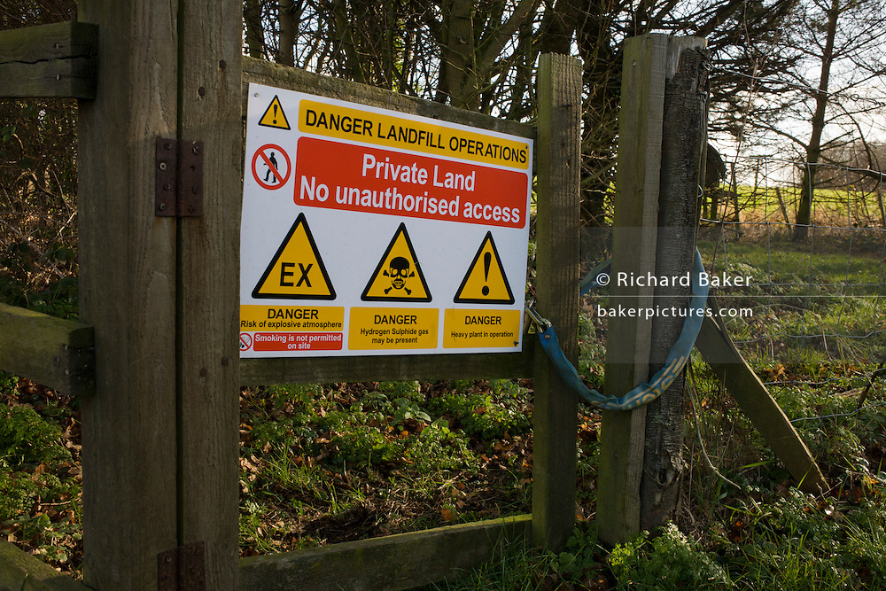 Sign warning to passers-by of chemical and biological landfill dangers on property owned by Waste Management, Offham, Kent.