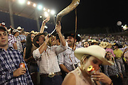 Cowboys and cowgirls attend a stadium where a rodeo competition is performed in Barretos during the Barretos Rodeo Fair in  Sao Paulo state, Brazil, Thursday, Aug. 23, 2012. Brazil is on a quick path to become a global power. Rising economy, big infrastructure projects, an emerging and eager consuming middle class and the booming national industry are the evidences and consequences of the wealth in the southern nation. But the often hidden source of all this wealth falls far from the luring Rio beaches or the Kolkata-New York mix that Sao Paulo is. Behind texan hats and a similar attitude the countrymen display their power through a myriad of projects, festivals and behavior visually analyzed here.
