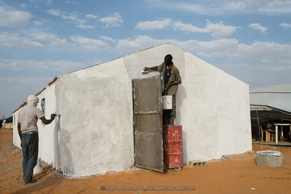 A new building being whitewashed at the Médecins Sans Frontières (MSF) health centre at the Mbera camp for Malian refugees in Mauritania on 3 March 2013. A number of buildings are being built to replace the tents currently in use, which are in danger of being blown away during seasonal sandstorms in the mddle of the year.