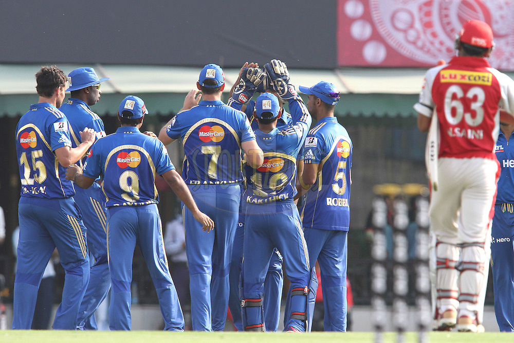 Mumbai Indians celebrate Nitin Saini of the Kings XI Punjab wicket during match 33 of the the Indian Premier League (IPL) 2012  between The Kings X1 Punjab and The Mumbai Indians held at the Punjab Cricket Association Stadium, Mohali on the 25th April 2012..Photo by Shaun Roy/IPL/SPORTZPICS