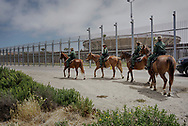 SAN YSIDRO, CA MAY 7, 2018:  Border Patrol agents patrol the area near where Attorney General Jeff Sessions addresses the media during a press conference at Border Field State Park in San Ysidro, CA on Monday, May 7, 2018.  Sessions was on a visit to the border along with ICE Deputy Director Thomas D. Homan to discuss the immigration enforcement actions of the Trump Administration.(Photo by Sandy Huffaker/Getty Images)