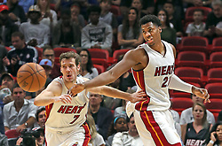November 28, 2016 - Miami, Florida, U.S. - Miami Heat GORAN DRAGIC and HASSAN WHITESIDE chase a loose ball in the second quarter against the Boston Celtics on Monday at the AmericanAirlines Arena. (Credit Image: © Charles Trainor Jr/TNS via ZUMA Wire)