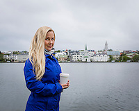 Young woman by Tjörnin - Reykjavík.