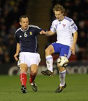 Football - International Friendly - Scotland vs Faroe Islands<br /> Charlie Adam of Scotland and Bogi Lokin ofForoe Islands during the International Friendly between Scotland and Faroe Islands at Pittodrie Stadium.
