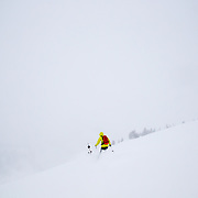 Andrew Whiteford traverses in-bounds across the top of Rendezvous Bowl at Jackson Hole Mountain Resort.