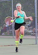 Iowa City West's Brittani Langland returns the ball during the Class 2A state team tennis tournament at Veterans Memorial Tennis Center in Cedar Rapids on Saturday, June 1, 2013.