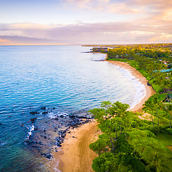 Maui Hawaii aerial drone photo of Keawakapu Beach at sunrise with Maalaea Bay. Keawakapu Beach is a popular spot in Wailea-Makena Kihei Hawaii. Copyright ⓒ 2019 Paul Velgos with All Rights Reserved.