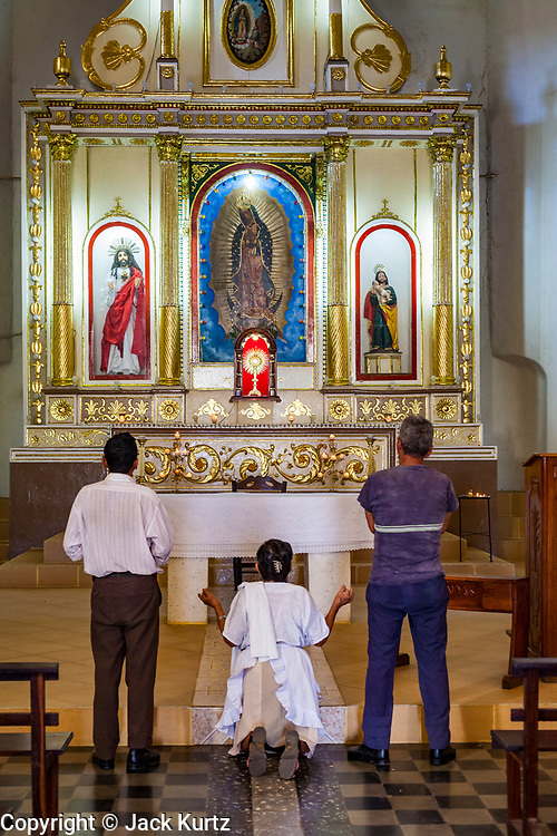 11 JANUARY 2007 - LEON, NICARAGUA: A woman prays in Guadalupe Church in Leon, Nicaragua. Leon was established in 1524 and was the capitol of what is now Nicaragua for more than 200 years. It was heavily damaged during the Sandanista war against the Somoza regime and it still one of the most liberal cities in Nicaragua.  Photo by Jack Kurtz
