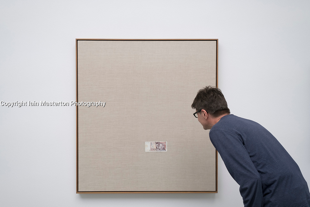 Man looking at painting by Sergej Jensen at Kunsthalle in Baden-Baden,  Baden-Wurttemberg, Germany. -editorial use only