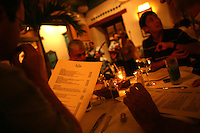 Customers look over the menu at La Vitrola, a popular restaurant in Cartagena's old city, on Thursday, August 21, 2008. (Photo/Scott Dalton)
