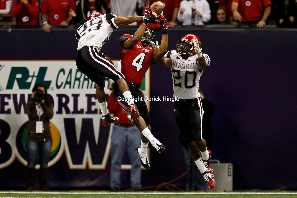 December 17, 2011; New Orleans, LA, USA;  Louisiana-Lafayette Ragin Cajuns wide receiver Javone Lawson (4) makes a catch over San Diego State Aztecs defensive back Larry Parker (29) and defensive back Nat Berhe (20)during the second half of the New Orleans Bowl at the Mercedes-Benz Superdome. Louisiana-Lafayette defeated San Diego State 32-30. Mandatory Credit: Derick E. Hingle-US PRESSWIRE