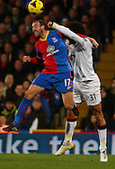 Glenn Murray of Crystal Palace and Marouane Fellaini of Manchester United in an aerial battle during the Barclays Premier League match at Selhurst Park, London<br /> Picture by David Horn/Focus Images Ltd +44 7545 970036<br /> 22/02/2014